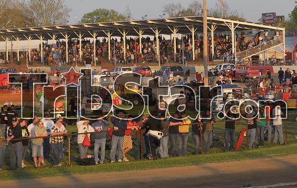 Hungry for racing: Race fans crowd the fence after a wreck near turn three during the inaugural Clabber Girl Don Smith Classic presented by Indiana State University Sunday, May 4 at the Terre Haute Action Track.