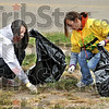 No ifs ands or butts: Terre Haute North freshmen Molly McKee and Nicole Lind pick thousands of cigarette butts between tenth and eleventh streets on Poplar Saturday morning.