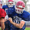 Double duty: Jarrid McLoughlin works against a teammate in practice last Monday. The middle linebacker for the Riverton-Parke football team also runs cross country for the school.
