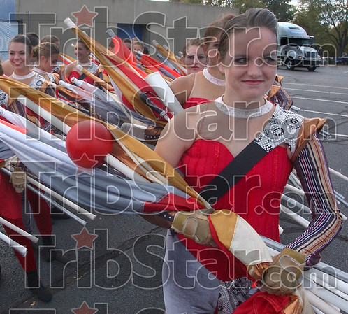Time for the show: Chelsea Caviness and other members of the Center Grove Guard stand ready for their turn to perform at the Marching Band competition Saturday evneing at Memorial Stadium.