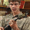 Mandolin melodies: Mandolin player Solly Burton, 17.