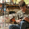 Fleet fingered: Seventeen-year-old Solly Burton works his way around his mandolin's fretboard as he plays on the couch Monday at his family's home near Graysville in Sullivan County.