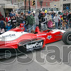 Indy Car: A two seater Indy Car cruises along the parade route Saturday morning.