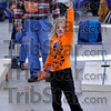 On target: Maeci Linz treis her hand at the game of cornhole while her dad Shane watches and waits his turn. They were attending the Clay County Community Foundation fundraiser Saturday evening.