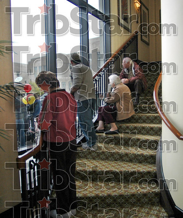 Best seats: Guests at the Hilton Garden Inn take advantage of the staircase view to watch the Indiana State Homecoming parade Saturday morning.