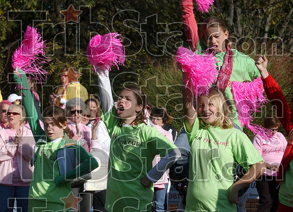 """I am the Cure!"": Chauncey Rose Middle School cheerleaders Chelsea Wilkie, Hailey Reynolds, Haley Booker and Chelsea Miller, top, lead a cheer with their their fellow cheerleaders for the participants of the 12th annual Wabash Valley Susan G. Komen Race for the Cure Saturday at St. Mary-of-the Woods."