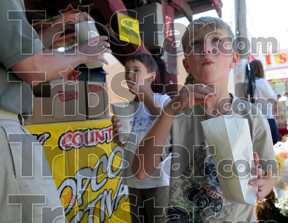 Yummy: Indianapolis residents Daniel Ceglio (R) and his brother Nick (L) enjoy some free popcorn at Brazil's annual Popcorn Fest in Forest Park Saturday.