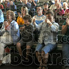 Thumbs up: Audience members show their approval for the popcorn eating contest entrants during the Popcorn Fest at Forest Park in Brazil Saturday afternoon.