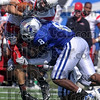Put a hit on somebody: Indiana State's Donye McCleskey (8) and a teammate tackles an Illinois State opponent during the Sycamores' game against the Redbirds Saturday at Memorial Stadium.