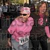 Laughing with the Pack: Mary Harbaugh laughs with friends and family, including friend, Sheila Dinkel, right, as she walks in the 12th annual Wabash Valley Susan G. Komen Race for the Cure Saturday at St. Mary-of-the-Woods College. Harbaugh, 41, of Terre Haute was diagnosed with breast cancer in June and is undergoing treatment.