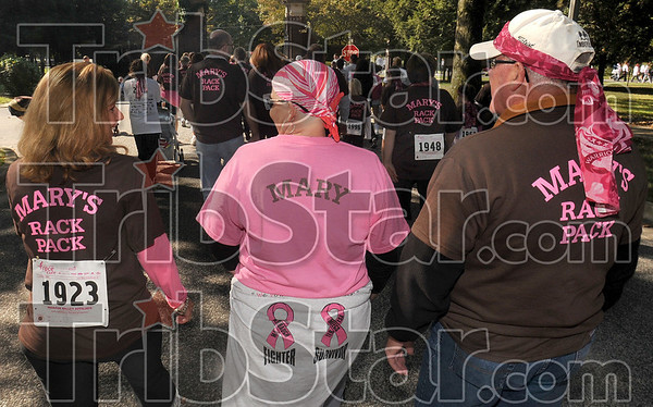 Full support: Mary Harbaugh, center, walks with supporters Sheila Dinkel and her father, Joe Card, during the Race for the Cure Saturday at St. Mary-of-the-Woods College.