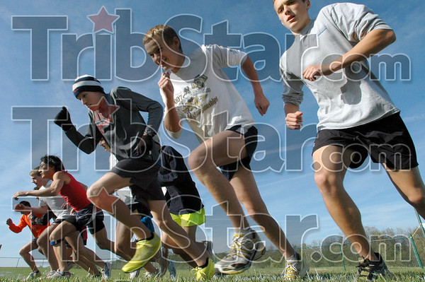 They're off: Members of the Terre Haute North cross country team embark on Wednesday's practice at the Givson Cross Country Course.