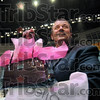 Up for bid: Rick Burger of Duke Engergy holds a handbag that went up for bid during Wednesday's auction at Hulman Center.