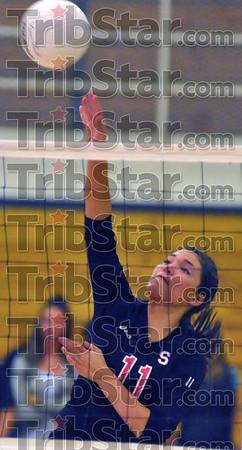 Net profit: Terre Haute South senior Morgan Rebeck spikes against Terre Haute North.