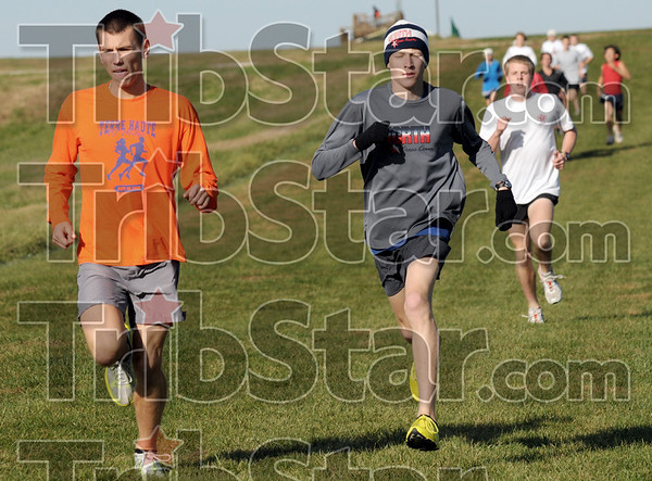 Practice: North's Brandon Query (L) leads a pack of North cross country runners during Wednesday's practice at the Gibson course. Center is John Mascari followed by John Davis in the white shirt.