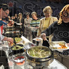 Chef: Corporate Executive Chef Eddie Wilson (L) prepares a dish for five hundred women that attended the fundraising event at Hulman Center Wednesday afternoo.