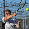 Forehand: Joel Modesitt hits a forehand winner against his sectional opponent Wednesday evening during sectional play in Vincennes. Modesitt won 6-1, 6-3.