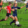 Hard fought: Rachel Fazekas tries to fight her way past North defender Megan Wilkey in the first half of their sectional soccer match Monday night. Fezekas scored the games only goal.