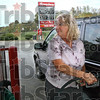 Below three dollars: Nancy Ping of Rosedale, Indiana puts Twenty dollars worth of gasoline into her car Monday afternoon at the Speedway station at US 41 and Carlisle road. Prices have dipped below three dollars per gallon.