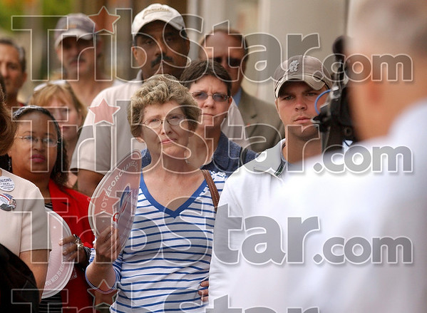 In support of Barack: Attendees listen as former Senator Evan Bayh, right, encourages them to vote for democratic presidential candidate Barack Obama outside of the Obama headquarters on Wabash Avenue Monday.