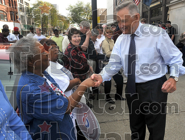 Nice to meet you: Former Indiana Senator Birch Bayh introduces himself to Barbara Ford after his speech Monday on Wabash Avenue in front of the Obama campaign headquarters.