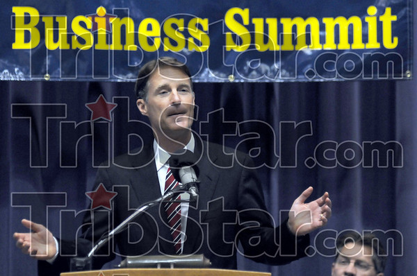 Summit: Senator Evan Bayh speaks at a small business summit jobs fair at Hulman Center Tuesday afternoon. At right is Mayor Duke Bennett.