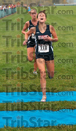 """Feeling it at the finish: Terre Haute North's Tayler Jackson feels the """"burn"""" at the finish of the girls' race of the Terre Haute North cross country sectional Tuesday at the LaVern Gibson course."""