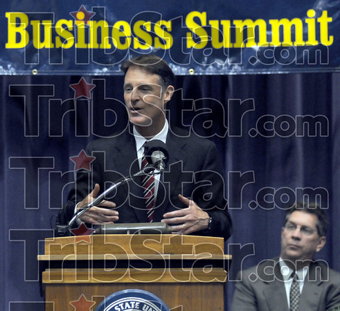 Speaker: Sentor Evan Bayh speaks at the Jobs Fair Small Business Summit Tuesday afternoon at Hulman Center. Listening at right is Mayor Duke Bennett.