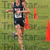 First place: Terre Haute North's Emily Cotterman crosses the finish line at the 20:21.4 minute mark Tuesday during the girls' race of the Terre Haute North cross country sectional at the Lavern Gibson course.