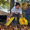 Helping hands: Angela Roberson gathers leaves from the side yard of her South29th stret home Tuesday afternoon.<br /> With several big oak trees and some smaller ones as well her Autumn will be busy. She is using plastic scoops designed to gather leaves.