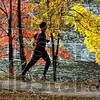 Run for fun: Rose-Hulman junior Andrew Meiers of Indianapolis runs a lakeside path in Hawthorn park Tuesday afternoon.