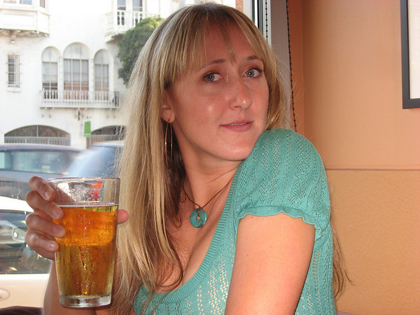 Adrienne sipping a beer as we wait for our food at Amici's before Oktoberfest by the Bay.