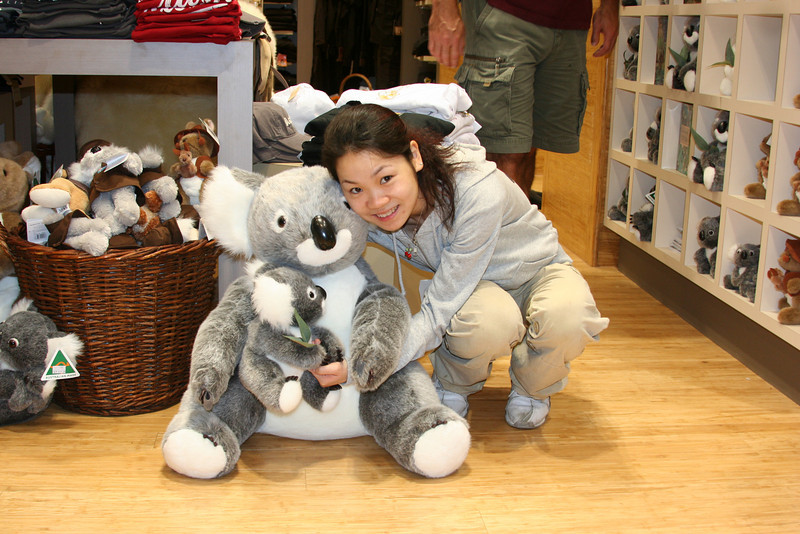 Hugging a stuffed Koala bear at the Port Douglas Airport -- flying to Ayers Rocks.  It was raining heavy that morning