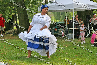 "Shauna Reeder-Gonzalez performs and interpretive dance to Cuban music in Downing Park, Sunday, September 14, 2008 as part of ""A Taste of Latin Culture."""