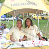 "Sylvia Cruz-Gomez and Diane Culpepper of Affinity Health Plan distribute information during ""A Taste of Latin Culture"" in Downing Park on Sunday, September 14, 2008."