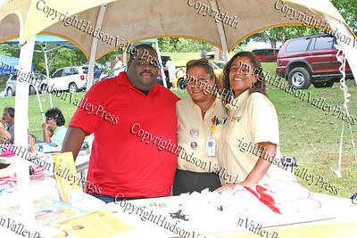 "Tyriek Summerville, Sylvia Cruz-Gomez and Diane Culpepper of Affinity Health Plan distribute information during ""A Taste of Latin Culture"" in Downing Park on Sunday, September 14, 2008."