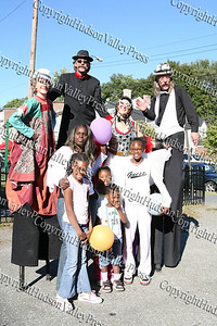 Tasha Cotten poses with children and the mortal Beasts and Deities during the First African American Unity Day Parade in 27 Years, held October 4, 2008 in the City of Newburgh.