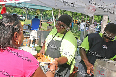 Shantell Muhammad of Soul Caribbean Cuisine serves up a delicious plate of food at the 13th Annual Latin American Festival in Beacon, NY.