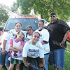 Stephanie, Alexsandra, Lisette, Jennifer, Tatianna and Manny Aviles by the Hudson Pontiac display of vehicles at the 13th Annual Latin American Festival in Beacon, NY.