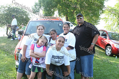 Stephanie, Alexsandra, Lisette, Jennifer, Tatianna and Manny Aviles by the Hudson Pontiac display of vehicles at the 13th Annual Latin American Festival in Beacon, NY.