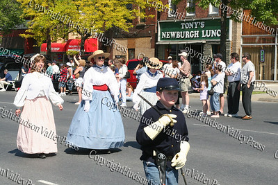 Wives of the Civil War Re-enactos march down Broadway in the City of Newburgh during the annual Memorial Day Parade.