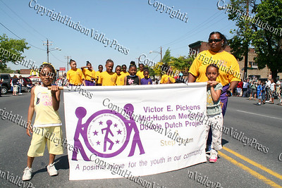Victor Pickens Double Dutch march down Broadway in the City of Newburgh during the annual Memorial Day Parade.
