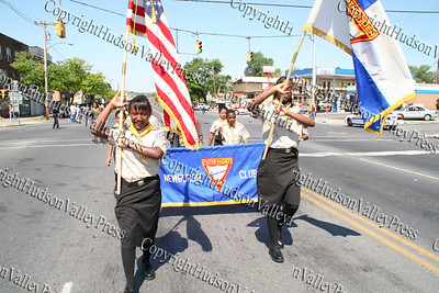 Girl Scouts march down Broadway in the City of Newburgh during the annual Memorial Day Parade.