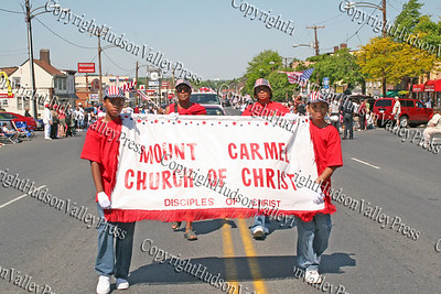 Mount Carmel Church of Christ march down Broadway in the City of Newburgh during the annual Memorial Day Parade.