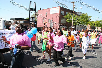 Church of God of Prophecy march down Broadway in the City of Newburgh during the annual Memorial Day Parade.