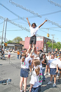 Meadow Hill Cheerleaders march down Broadway in the City of Newburgh during the annual Memorial Day Parade.