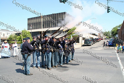 Civil War Re-enactors fire their guns as they march down Broadway in the City of Newburgh during the annual Memorial Day Parade.