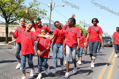Friends Youth Court march down Broadway in the City of Newburgh during the annual Memorial Day Parade.