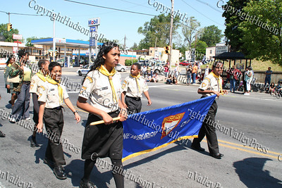 Girl Scouts and Cub Scouts march down Broadway in the City of Newburgh during the annual Memorial Day Parade.