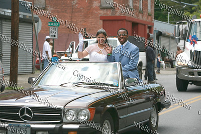 Debutante Jenna Marie Vann and Gentlemen Justin Caesar wave to the crowds on South Street in the City of Newburgh during the Third Annual Youth Pride Parade, held on Saturday, May 17, 2008.